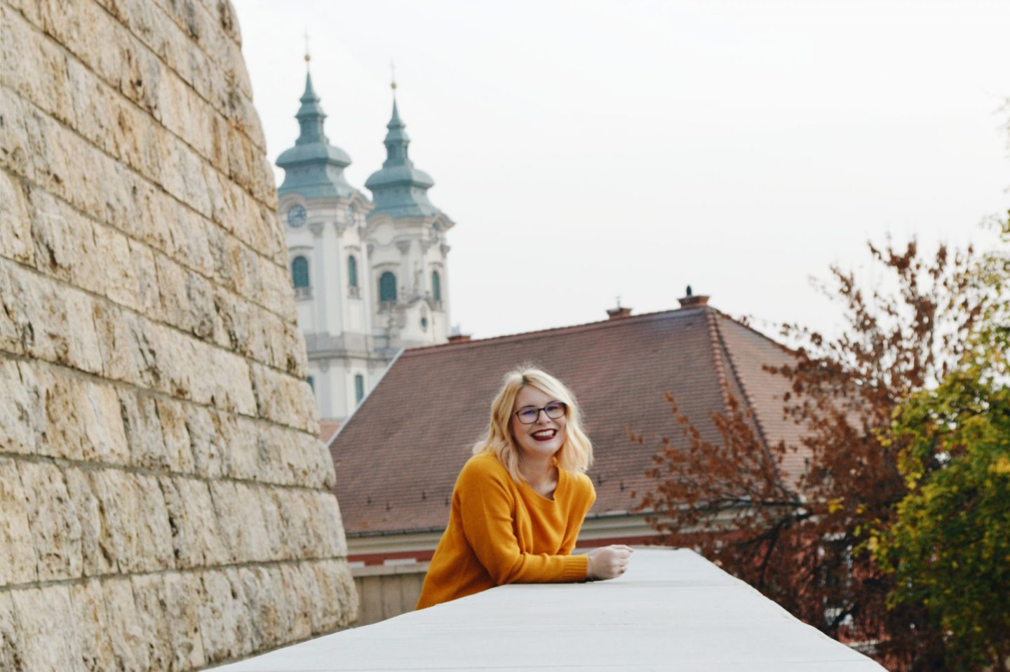 Blonde girl near the castle