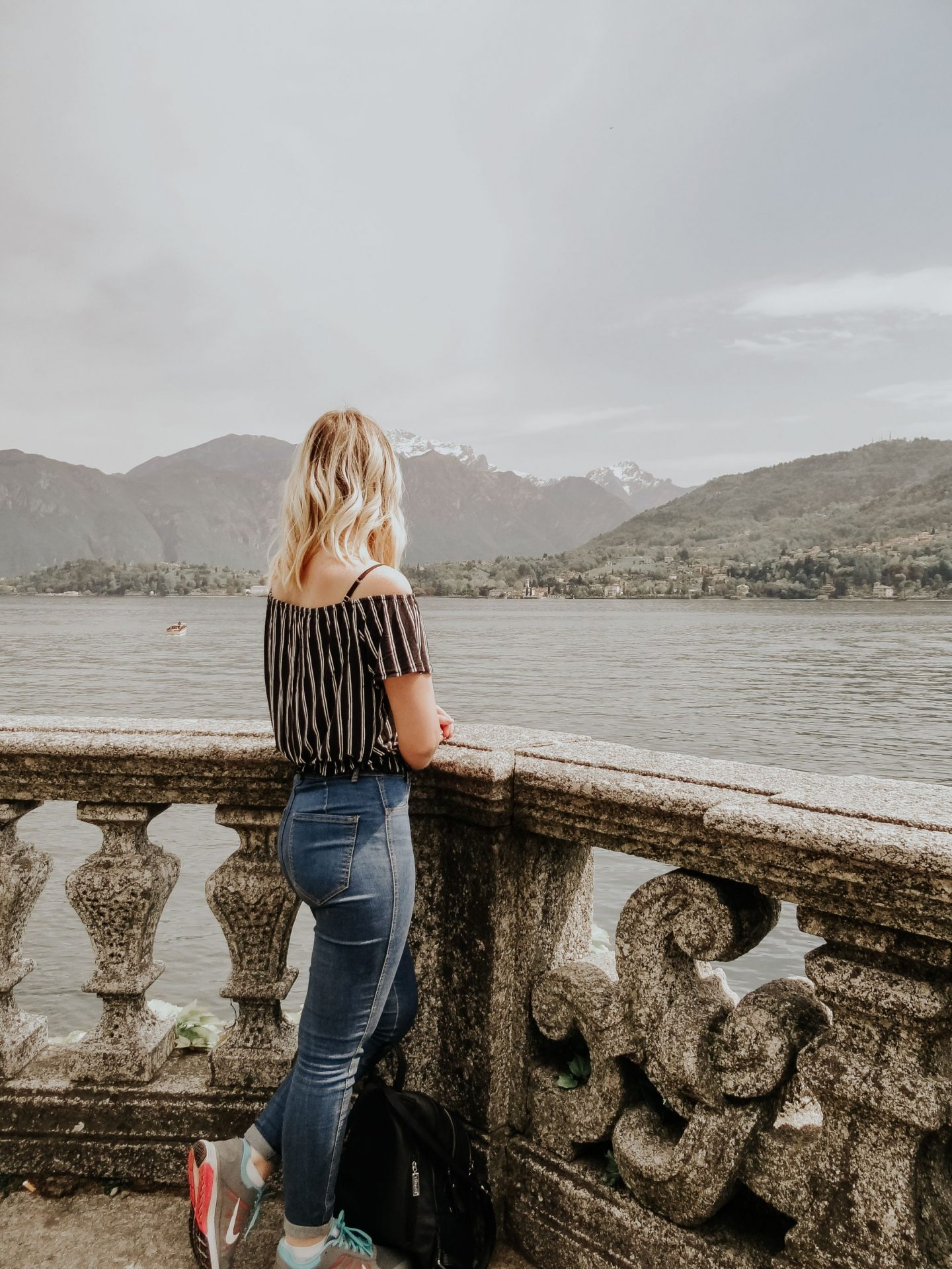 Blonde girl near lake como