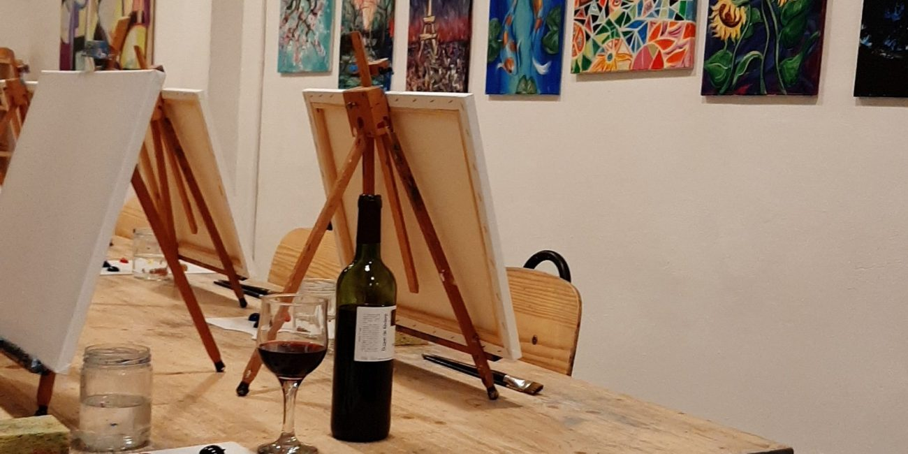 Painting and sipping wine with locals in Arte Bar, Barcelona